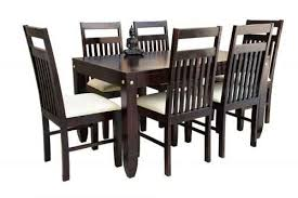 pencil leg table and chairs buy 6 seater pencil walnut finish dining table with jailro walnut