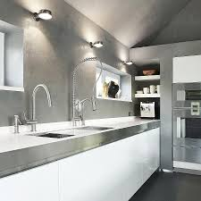 white cabinets and faucets plus stainless steel kitchen island