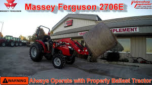 massey ferguson compact u0026 utility tractors lifting round bale