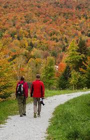 littleton hampshire fall foliage colors tourist couple walking