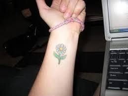 yellow flower tattoos 23 daisy flowers wrist tattoos