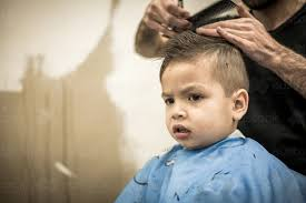 pictures of hair cut for year image of three year old mixed race boy having a haircut austockphoto