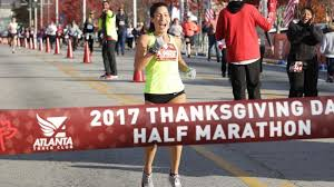 former uga runner christoforou wins thanksgiving day half marathon nbs