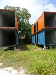 he bought 4 shipping containers and stacked them take a look at
