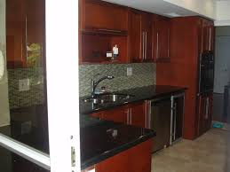 Cherry Wood Kitchen Cabinets With Black Granite Coral Springs Kitchen Remodeling By Able Quality Contracting