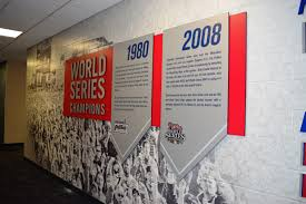 sports facility wall mural designs by oai visual branding lobby with brushed aluminum display championship wall with sintra displays