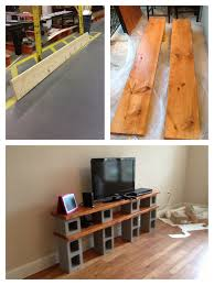 our tv stand cinder blocks concrete and stained wood diy