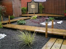 landscape of japanese garden with wooden deck and natural garden