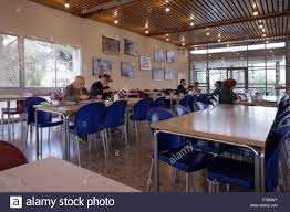 people eating in the dining room of kibbutz tzuba in the judean