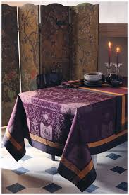 eggplant colored table linens the deep eggplant color of this tablecloth is made even richer with