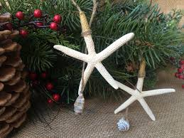 gold tipped starfish ornament with shell sea 2 land designs