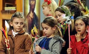catholics around the world celebrate palm sunday