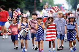 children celebrating 4th july with independence day parade