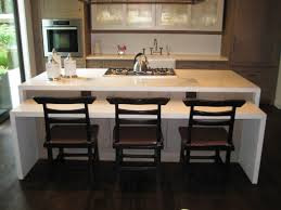 concrete waterfall edge kitchen island this two tiered design