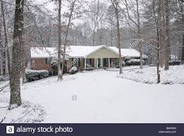 ranch style home snow falling on a ranch style home georgia usa stock photo