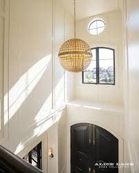 Front Door Chandelier Arched Black Front Doors With Gold Globe Pendant Contemporary