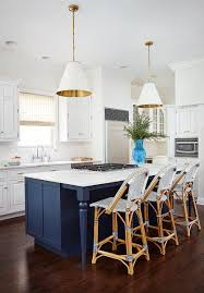 white kitchen painted navy blue island gold white pendant