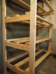 Basement Wooden Shelves Plans by Garage Shelf Plans Easy Economical Garage Shelving From 2x4s Free