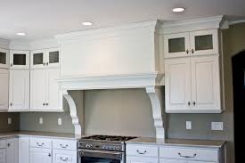 4 custom range hood large corbels rest on the countertop painted