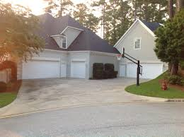 front yard hoop in the driveway the 3 car garage is definitely