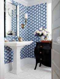 interesting blue bathroom with geometric wallpaper and white