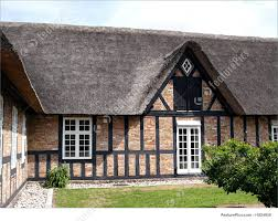 country farmhouse thatched straw roof denmark photo