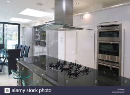 modern kitchen extractor fans extractor fan above hob in black granite island unit in modern