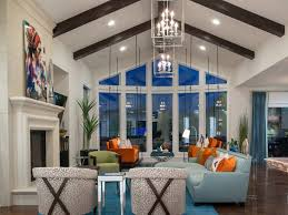 Vaulted Ceiling Open Floor Plans Blue Area Rug Vaulted Ceilings Orange Sofas Throw Pillows Recessed