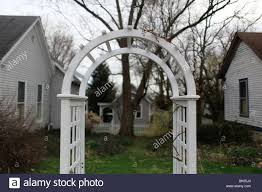 trellis archway surrounded by houses homes housing bloomington