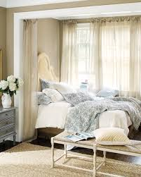 8 canopy inspired beds why we love them how to decorate canopy inspired bed created with sheer linen drapery panels