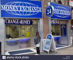 the shop bureau de change exchange change shop signs stock photo