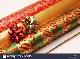 rolls of festive seasonal gift present wrapping