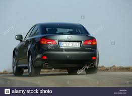 black lexus lexus is 250 model year 2005 black driving diagonal from the