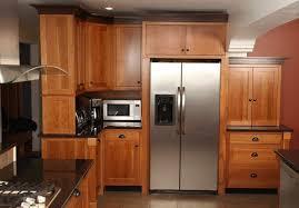 kitchen room walnut kitchen cabinets with black appliances