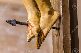 nailed of jesus on the cross stock photo picture and