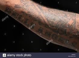 tattoos of a member of the motorcycle hells are