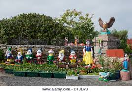 snow white and the 7 dwarfs garden gnomes for sale stock photo