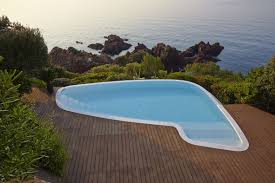 photo 8 of 8 in 8 of the best modern pools to dream of before the the swimming pool was reshaped and refinished to blur the transition between deck and rocky outcrop