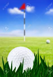 golf ball on a golf course with the green in the background