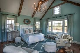 dream house with cape cod architecture and bright coastal master bedroom with coastal style soft colors
