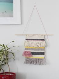 decorating simple striped tapestry wall hangings with white paint