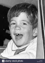 john kennedy jr smiles from the president u0027s limousine following