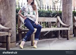 young model sitting on bench wearing stock photo 480458275