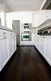 Should You Put Hardwood Floors In Kitchen - our kitchen before after dark wood dark and woods
