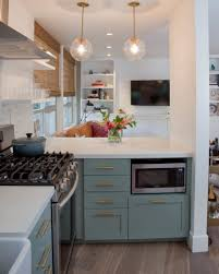 Small Kitchen With Reflective Surfaces Kitchen Peninsula Designs That Make Cook Rooms Look Amazing