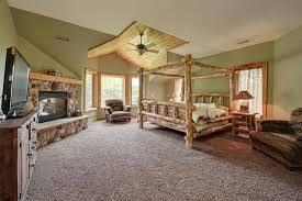 Master Bedroom Carpet Rustic Master Bedroom With Carpet Ceiling Fan In Oconomowoc Wi