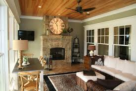 sunroom with fireplace porch rustic with cabin ceiling lighting