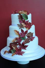 three tier wedding cake with cascade of autumn leaves blueberry