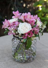 mason jar with pink alstroemeria cream roses and wax flower for a