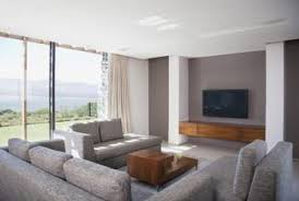 How To Decorate A Long Wall In Living Room How To Arrange A Sofa And A Love Seat In A Long Room Home Guides